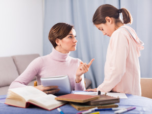 Mother does remarks daughter for incorrectly solved school homeworks